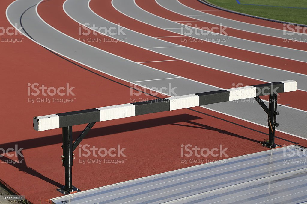 Track and athlete hurdling field royalty-free stock photo