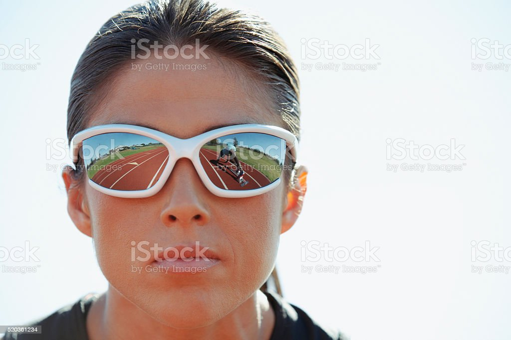 Track and field athlete with sunglasses stock photo