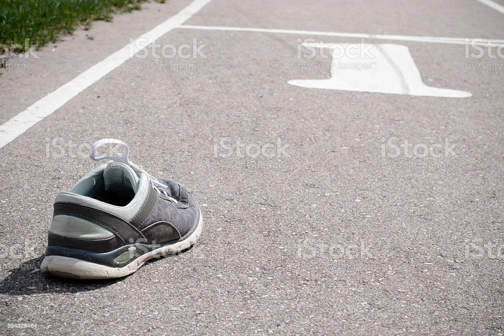 track and field course empty shoe up stock photo