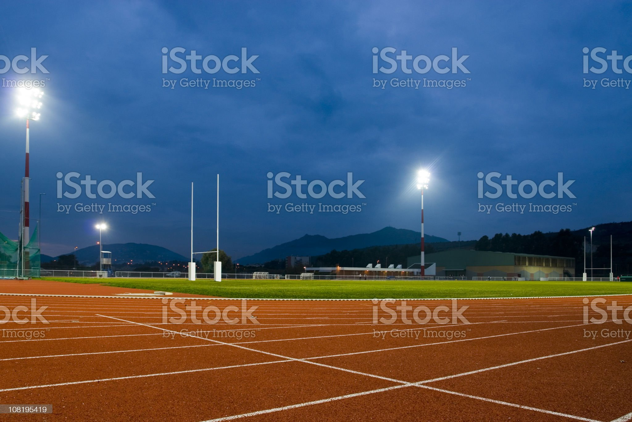 Track and Field Stadium at Night royalty-free stock photo