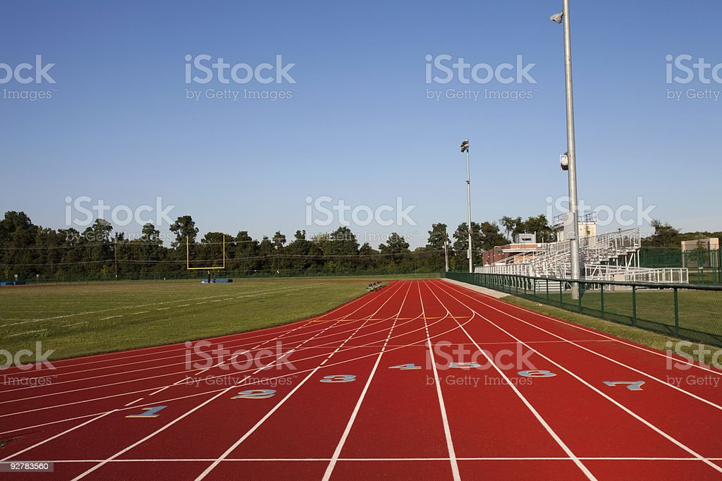 Track And Football Field Venue at Hgh School Clear Day stock photo