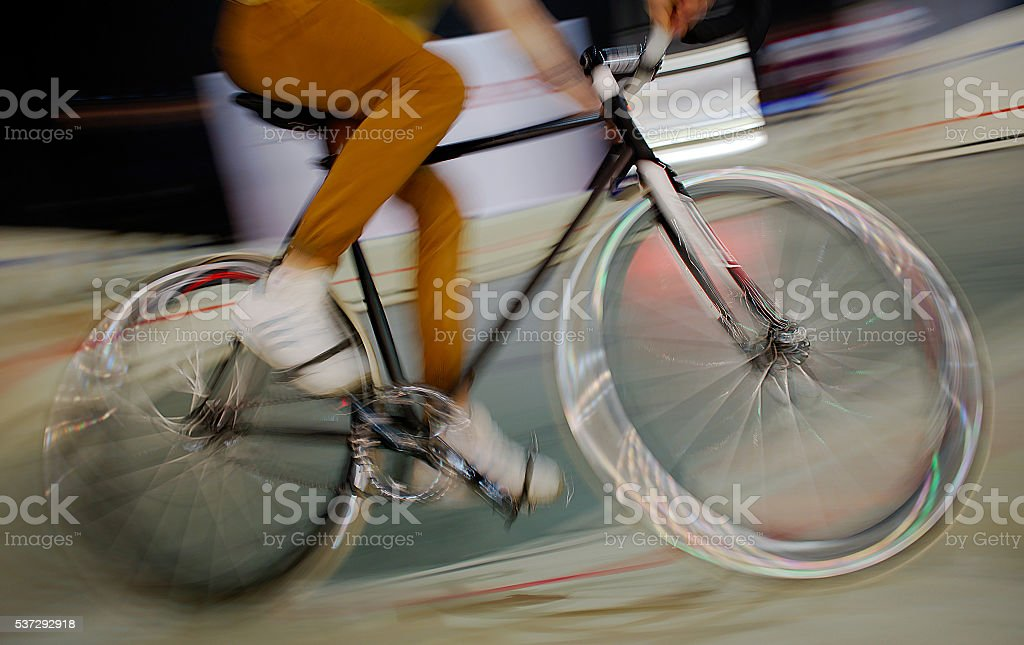 track cyclist in blurred motion stock photo