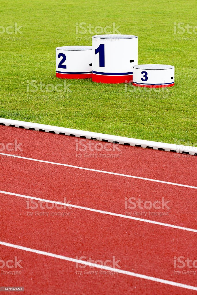 Track lanes with winner's podium stock photo