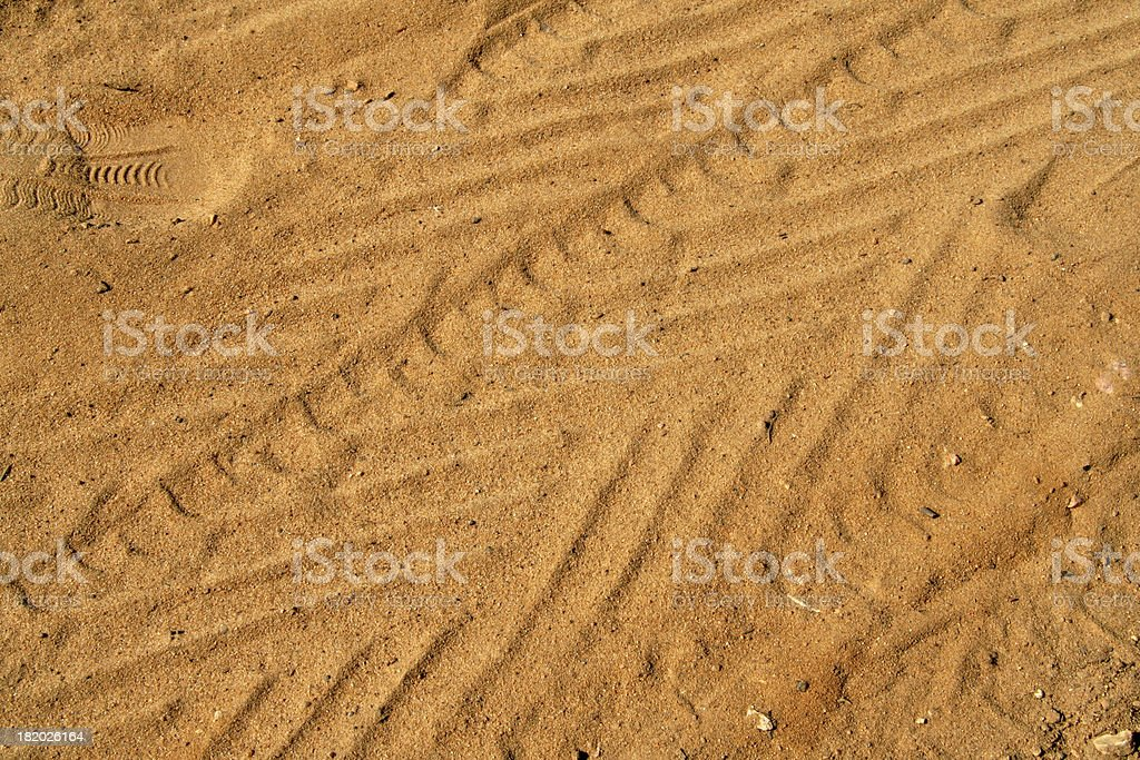 Track of car and a footprint. royalty-free stock photo