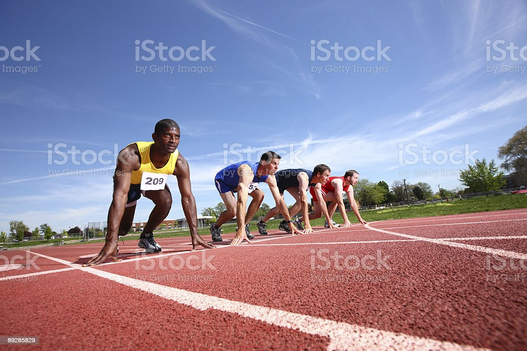 Track runners at starting line royalty-free stock photo
