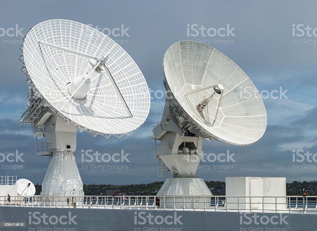 Tracking Satellite Dishes stock photo