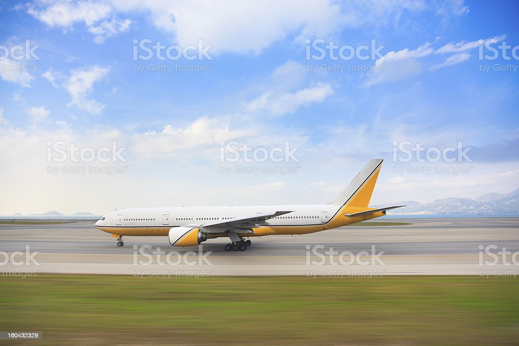 Tracking shot for taxiing airplane along the runway royalty-free stock photo