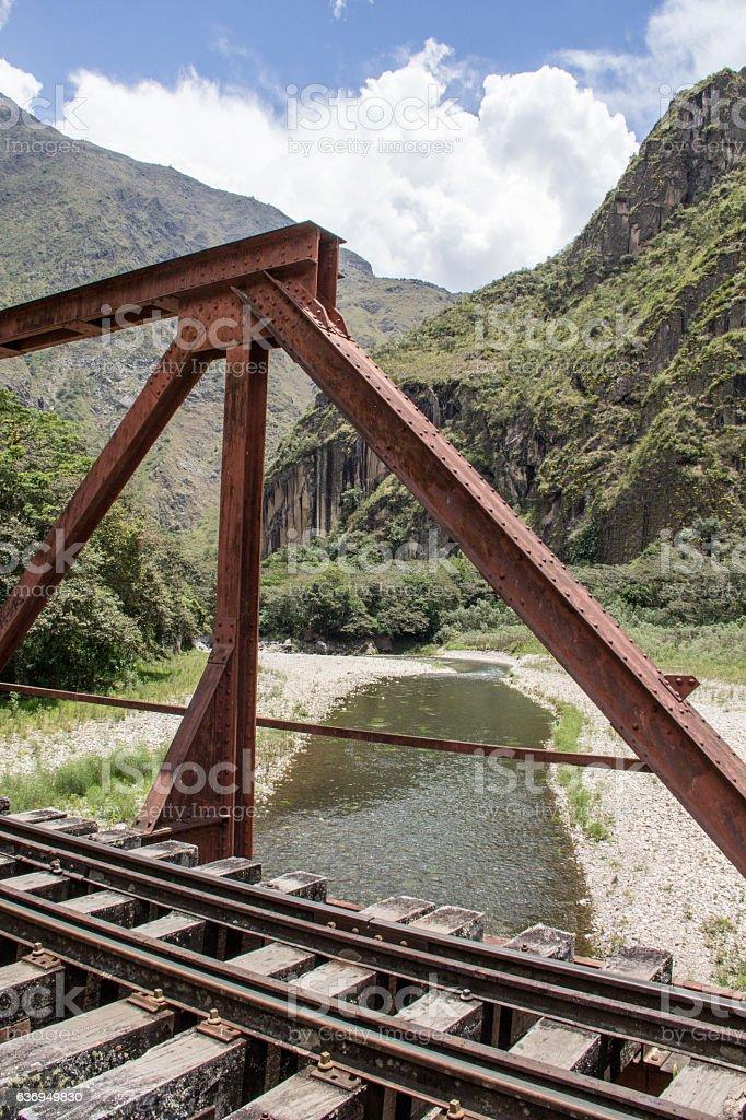 Tracks (rail) on a red iron bridge, over Vilcanota river stock photo