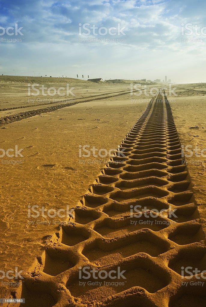 tracks on the beach stock photo