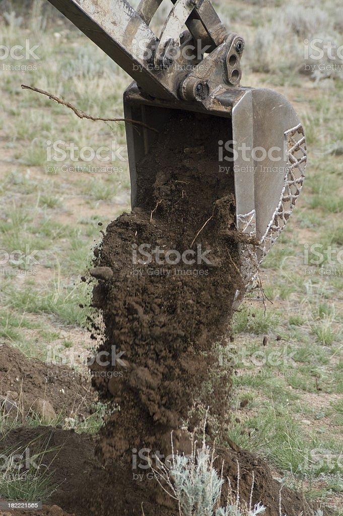 Trackscavator Bucket Dumping Dirt royalty-free stock photo