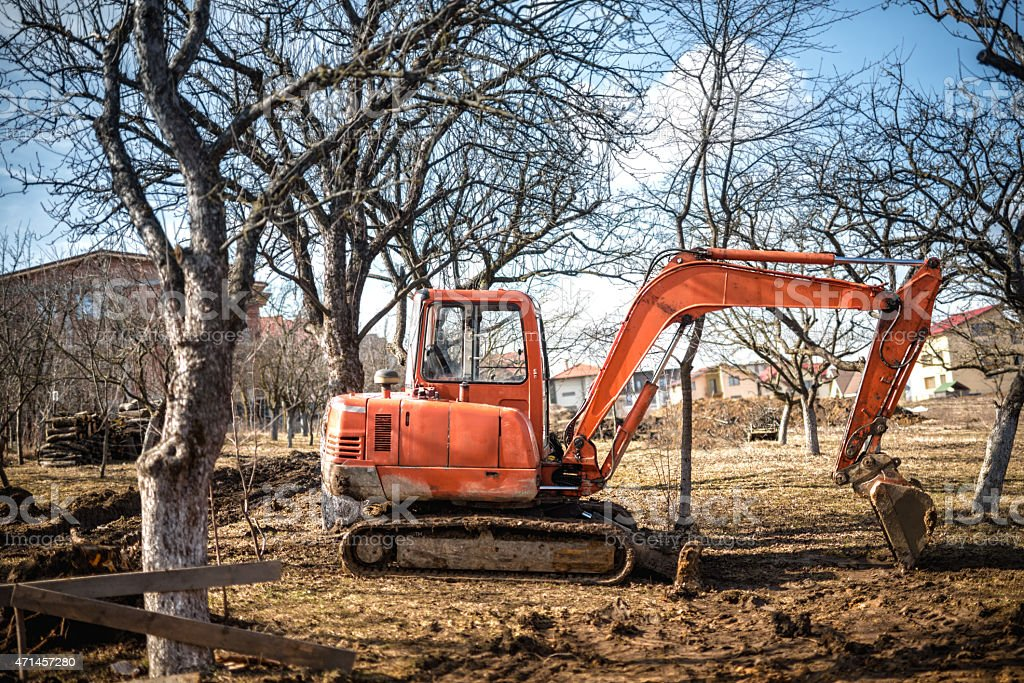 track-type excavator loader and backhoe working on earth stock photo