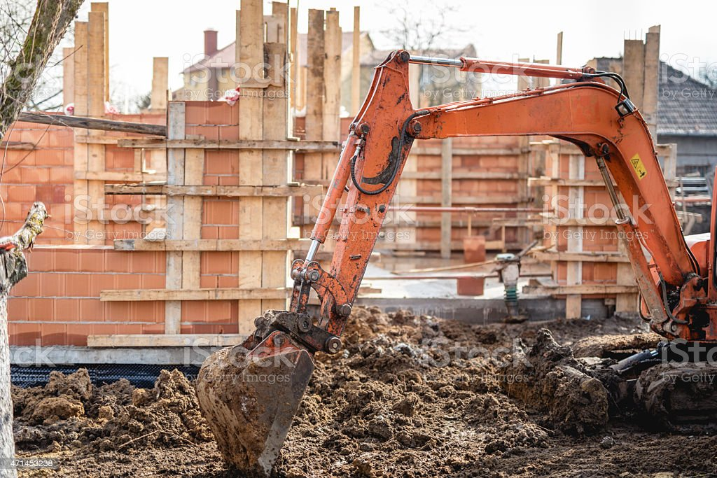 track-type excavator loader working on earth and loading stock photo