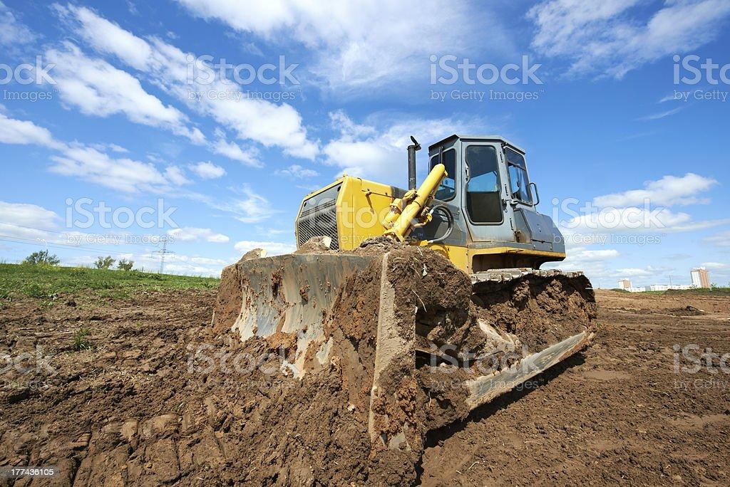 track-type loader bulldozer excavator at work stock photo