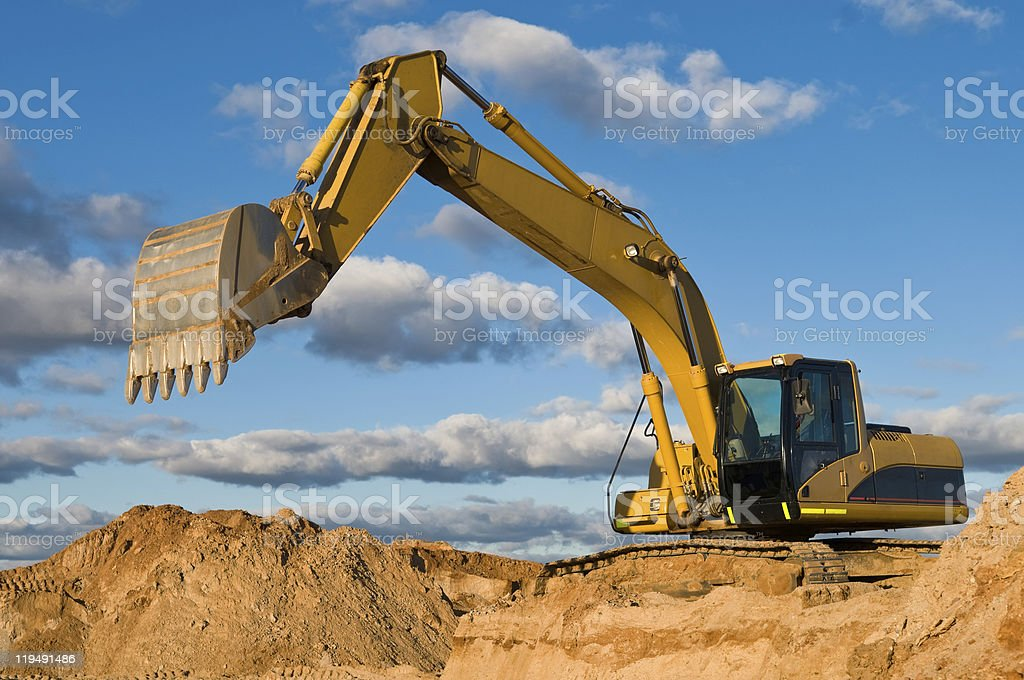 track-type loader excavator at sand quarry stock photo