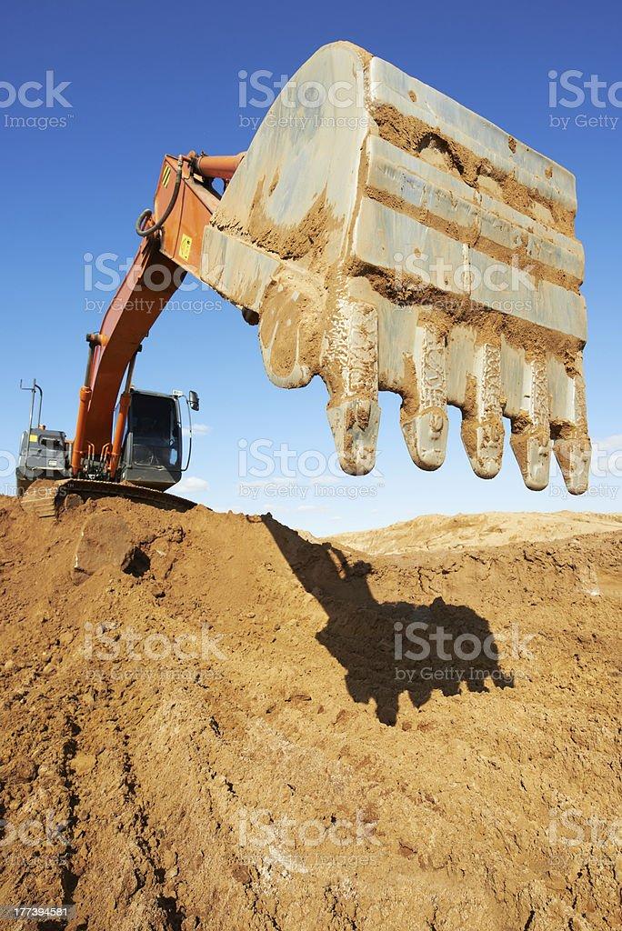 track-type loader excavator at work stock photo