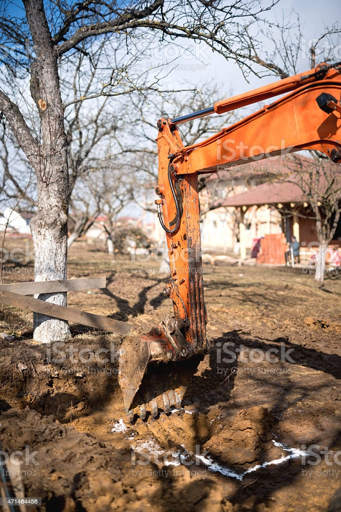 track-type loader excavator digging and leveling construction site stock photo