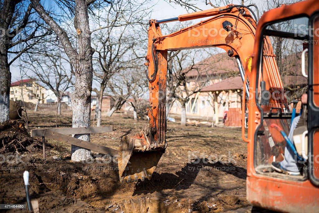 track-type loader excavator digging house foundation stock photo