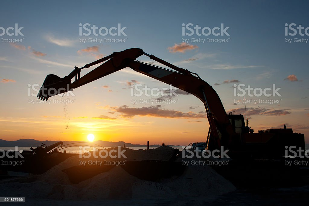 track-type loader excavator machine doing earthmoving work at sa stock photo