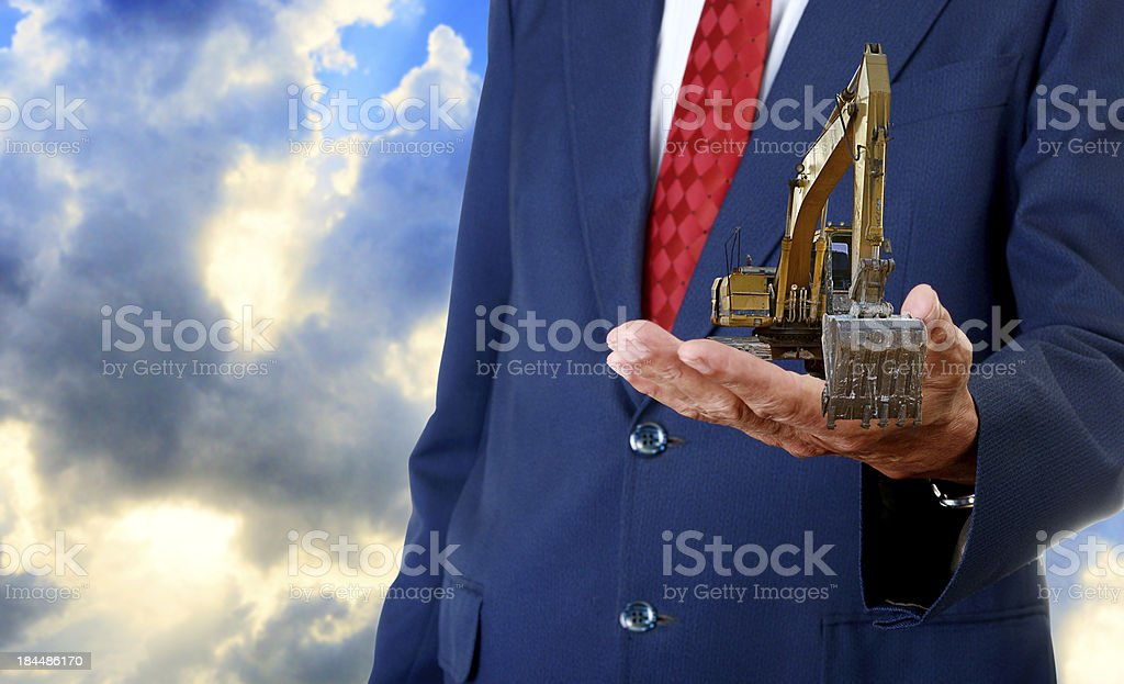 Track-type loader excavator machine on hand, Construction concept stock photo