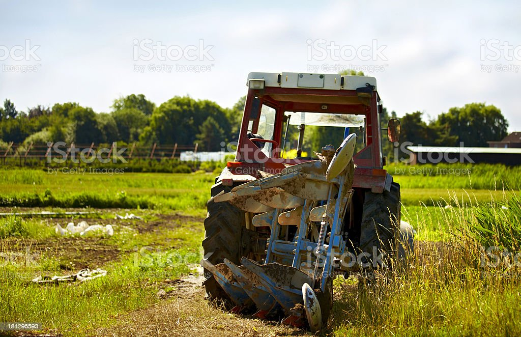 Tractor after work in field stock photo
