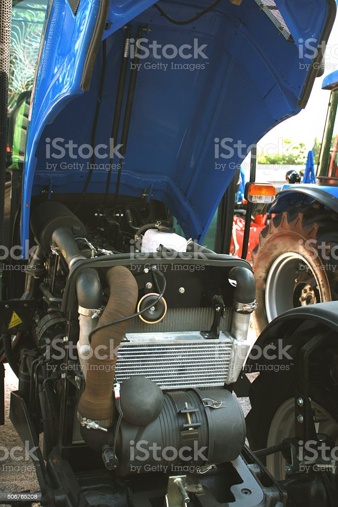 tractor, agricultural motor vehicle parts, part of the diesel en stock photo
