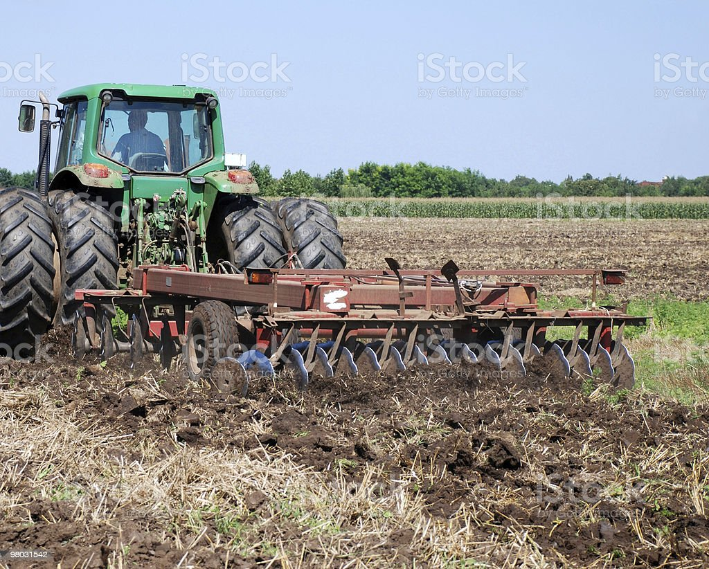 tractor and disk harrow stock photo