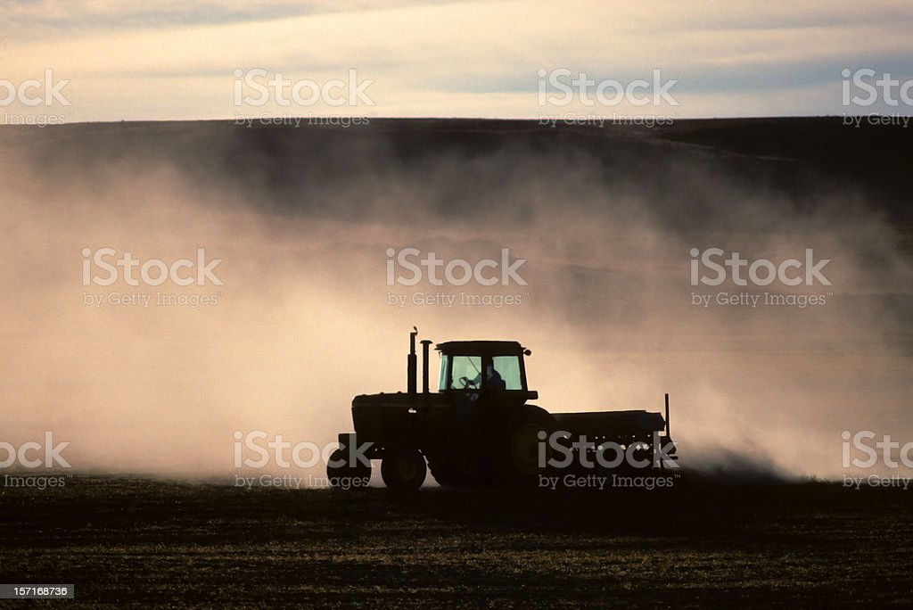 tractor and dust stock photo