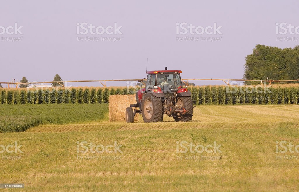 Tractor and Hay Bale royalty-free stock photo