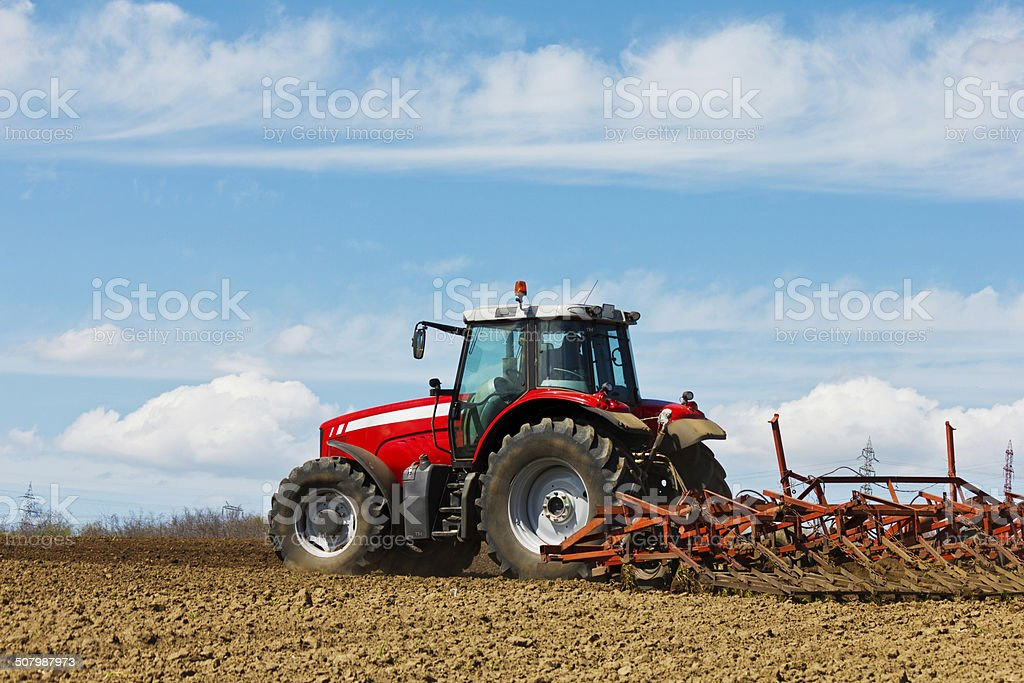 Tractor and Plow stock photo
