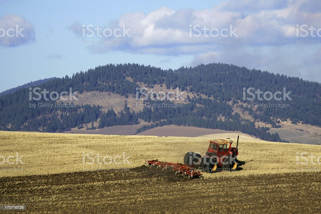 tractor and tiller royalty-free stock photo