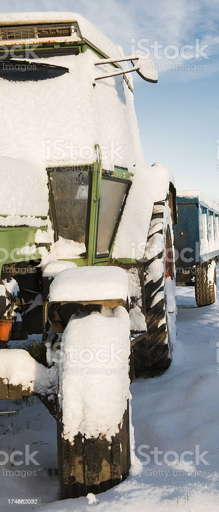 tractor and trailor in snow royalty-free stock photo