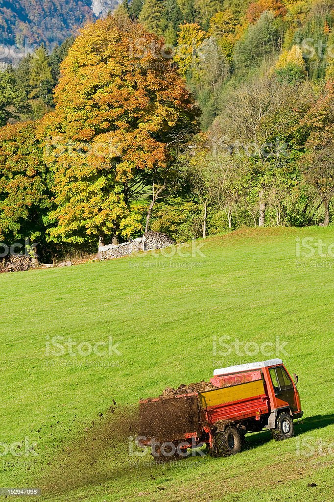 tractor at work on filed royalty-free stock photo