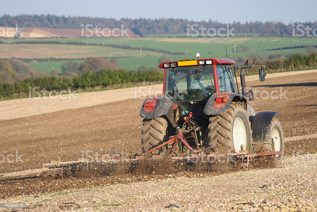 Tractor breaking up the soil royalty-free stock photo