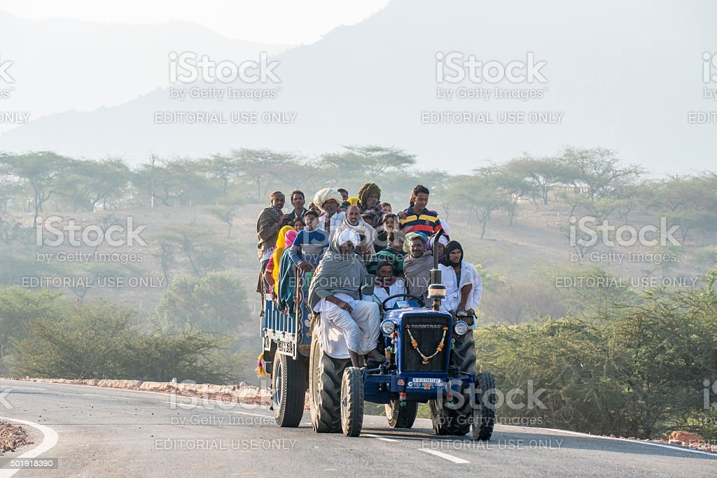Tractor carrying passengers on road to Camel Fair, India stock photo