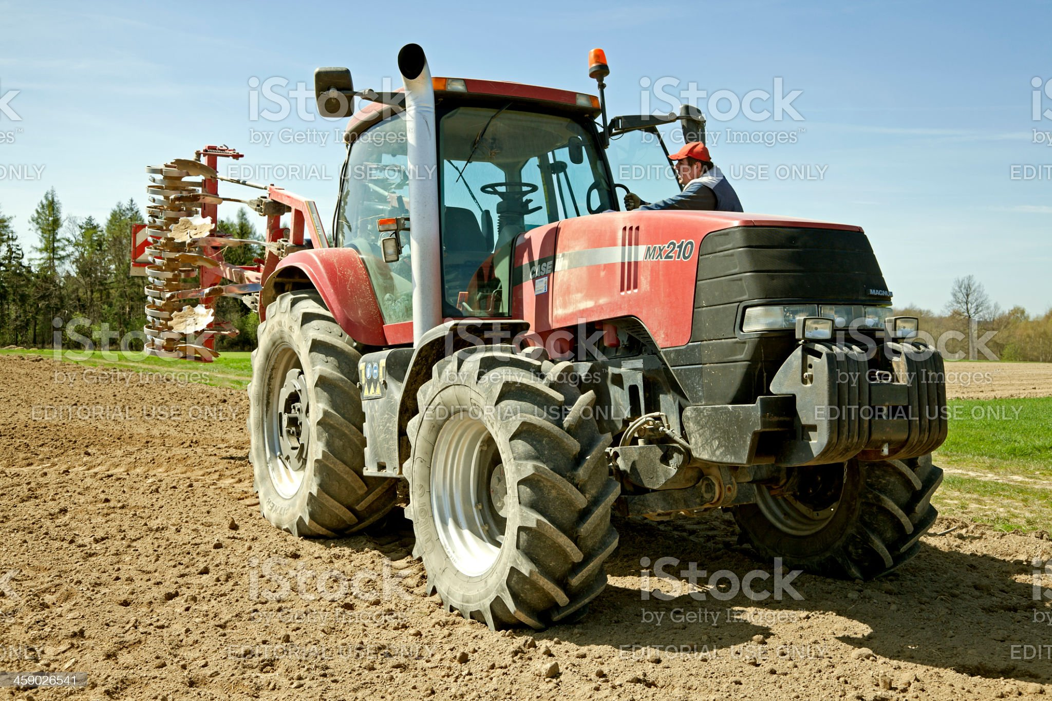 Tractor Case and cultivator Horsh royalty-free stock photo