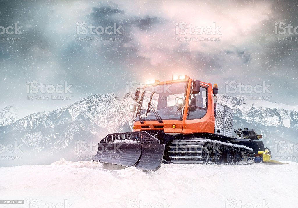 Tractor cleaning snow outdoors stock photo
