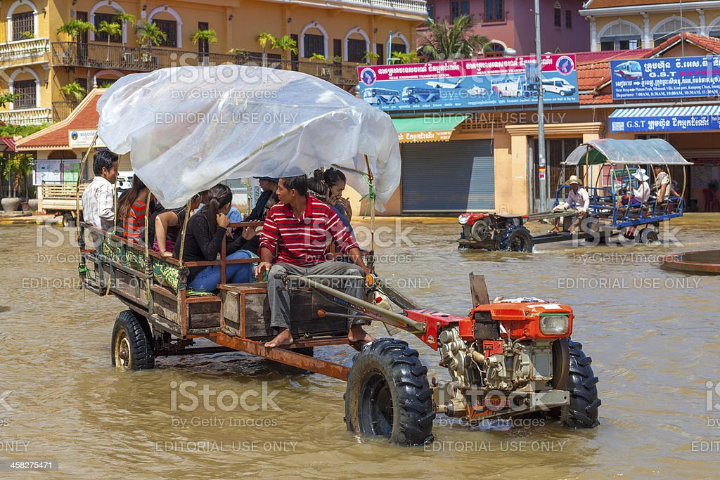 Tractor drives through floodwaters, Siem Reap, Cambodia royalty-free stock photo