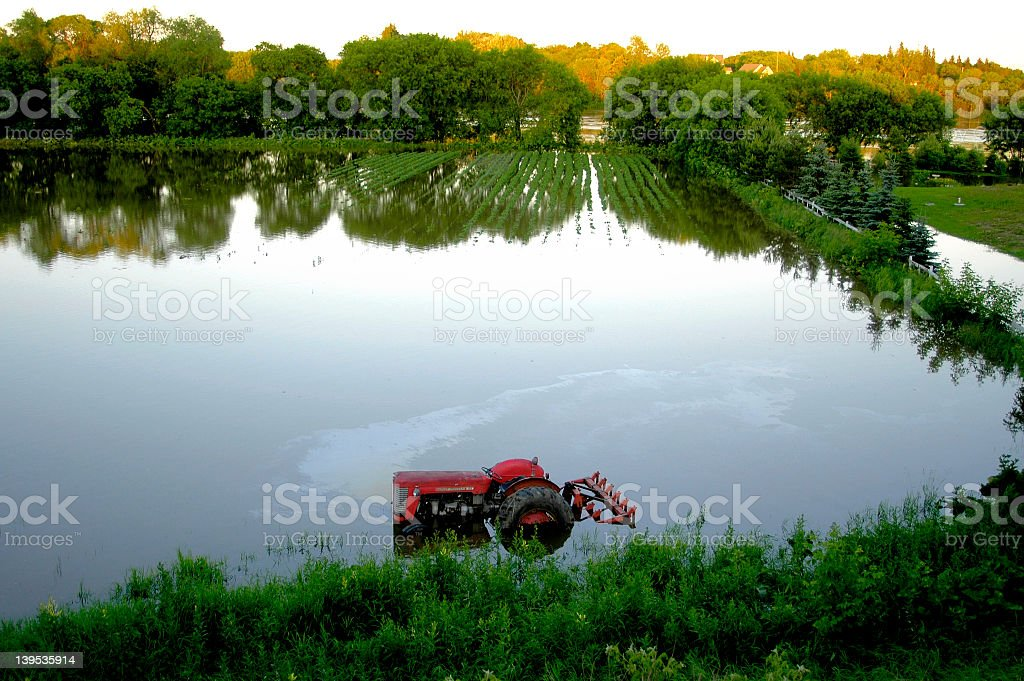 A tractor flooded in the field stock photo