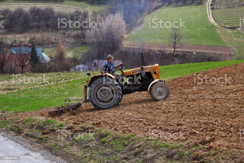 Tractor Harrowing Field stock photo