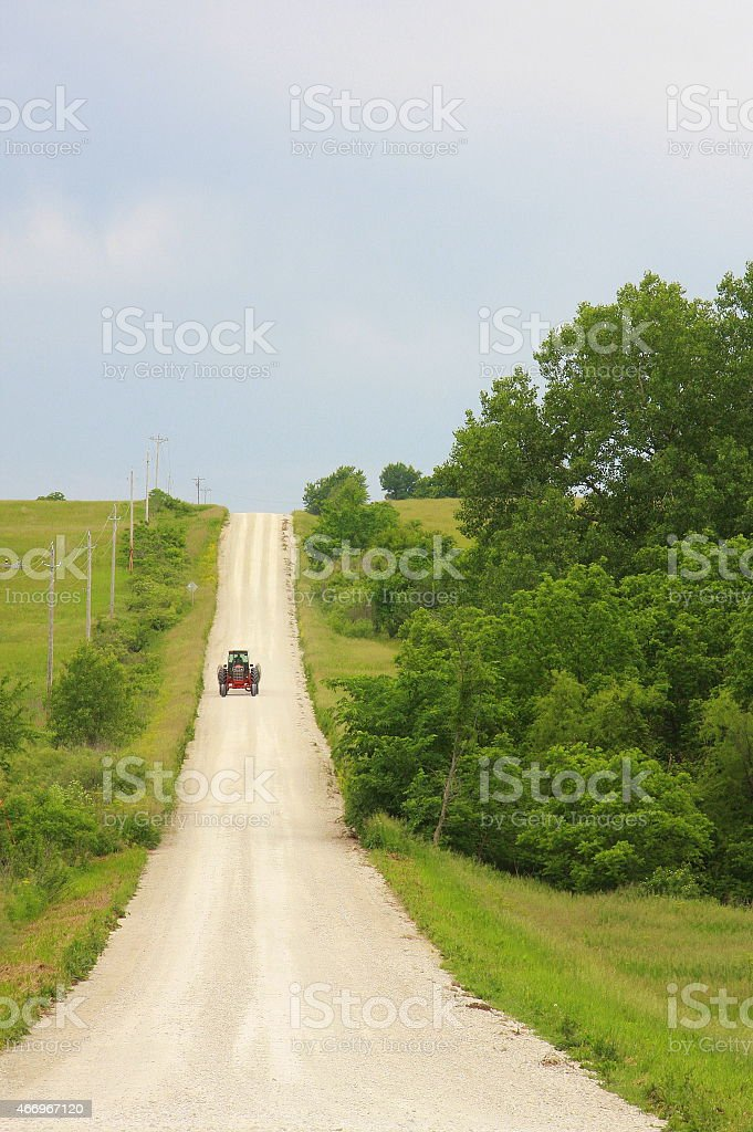 Tractor Heads Down an Iowa Road stock photo