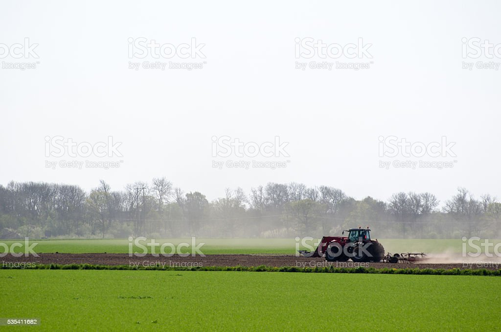 Tractor in a dry landscape stock photo