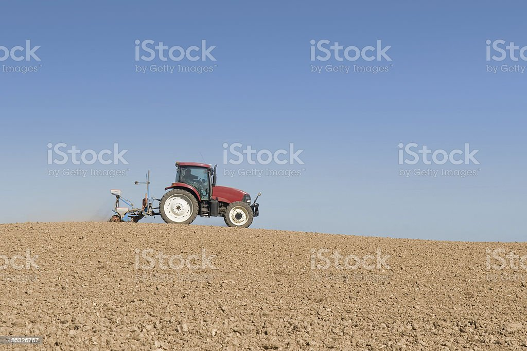 tractor in a field royalty-free stock photo
