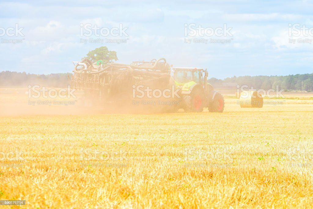 Tractor in dust stock photo