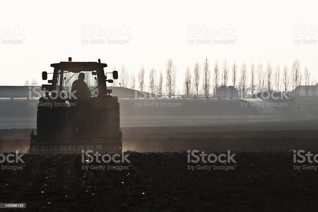 Tractor in field stock photo