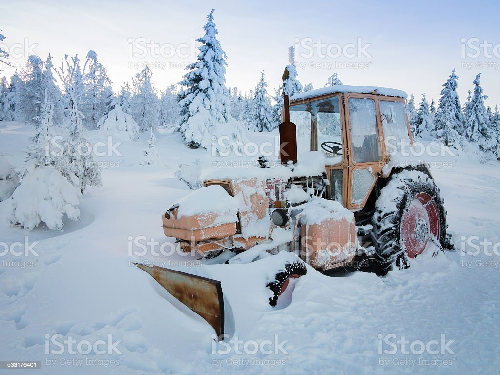 Tractor in snow stock photo