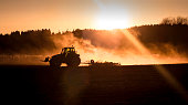 Tractor in sunset light