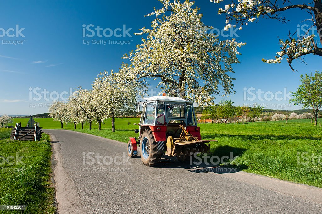 Tractor in the Spring stock photo