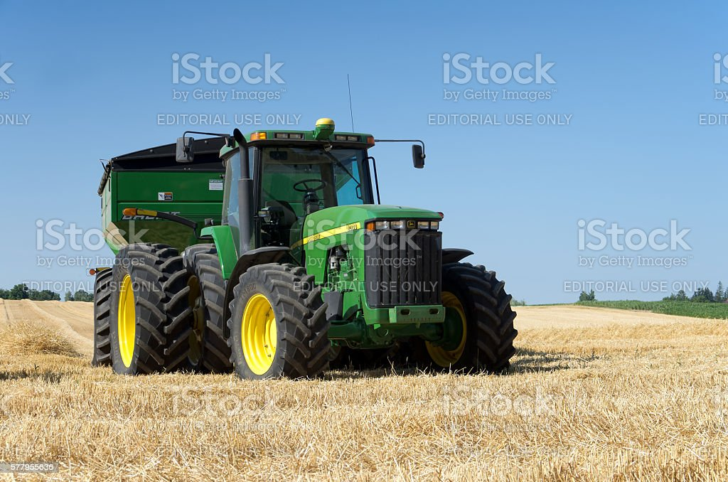 Tractor in Wheat Field stock photo