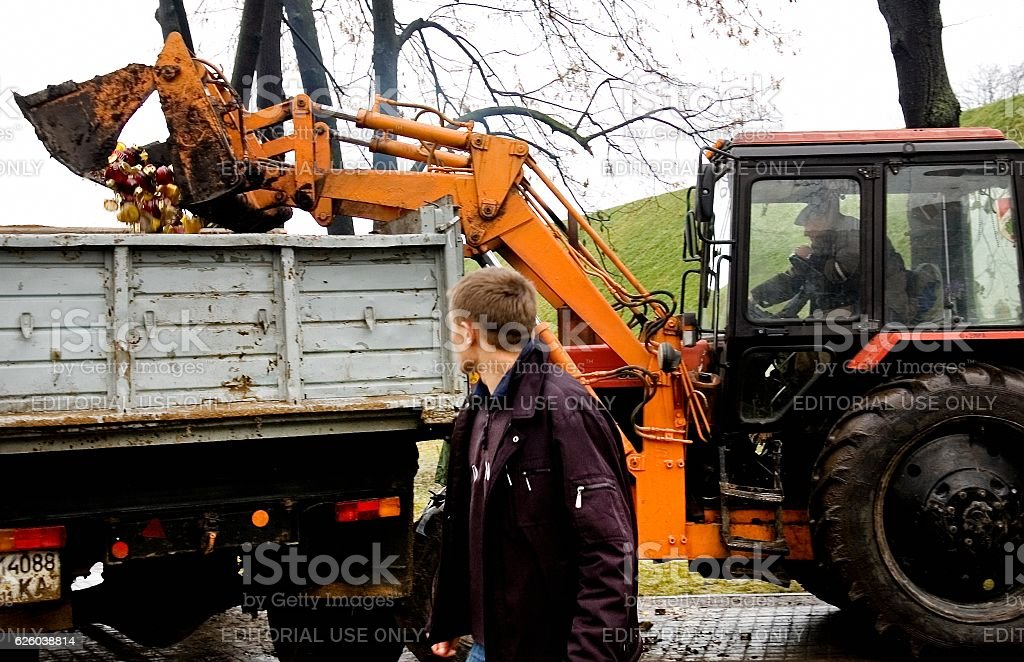 Tractor loading extinguished candles stock photo