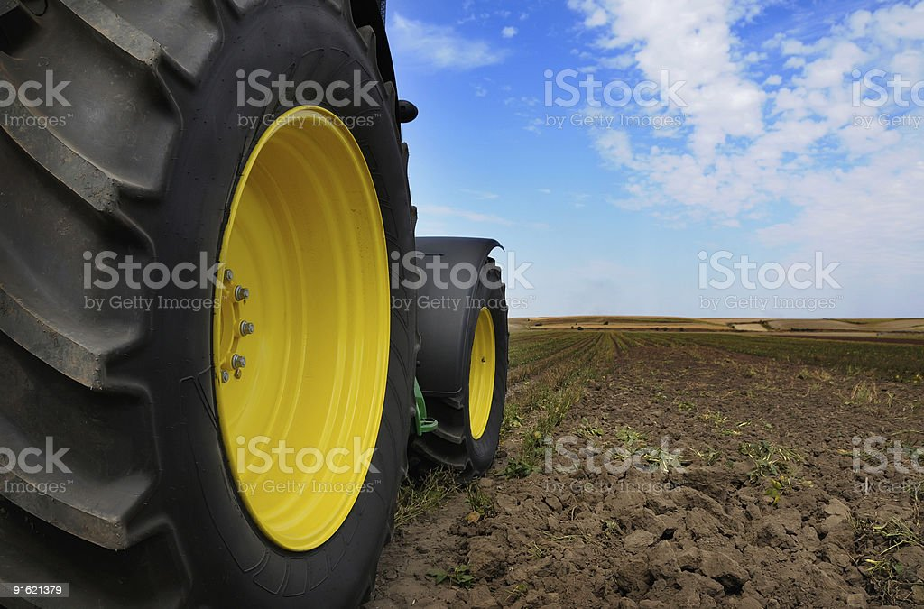 Tractor - modern agriculture farm equipment in field royalty-free stock photo